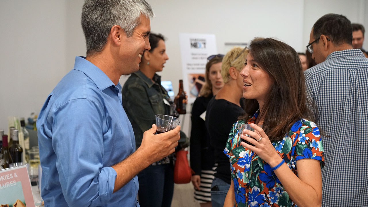 Hadar Greenfield (right) talking with drone entrepreneur Dor Abuhasira at an IAC networking event (Photo/Yuval Greenfield)