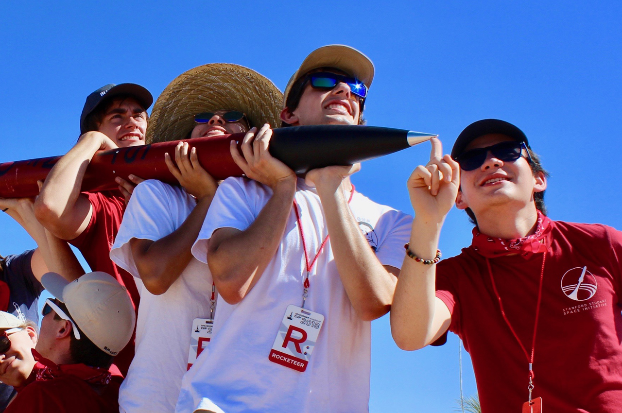 Daniel Shorr (far right) and other members of Stanford's Student Space Initiative escort a rocket he built (Photo/Courtesy Daniel Shorr)