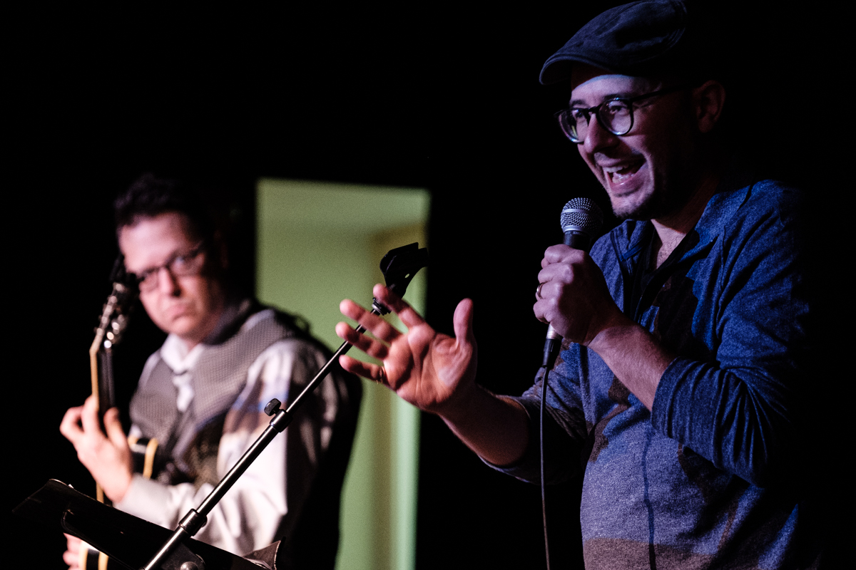 Poet Jake Marmer (right) recites his poetry at LABA's DRUNK event at the JCC East Bay in Berkeley, Nov. 23, 2019, accompanied by guitarist John Schott. (Pete Rosos)