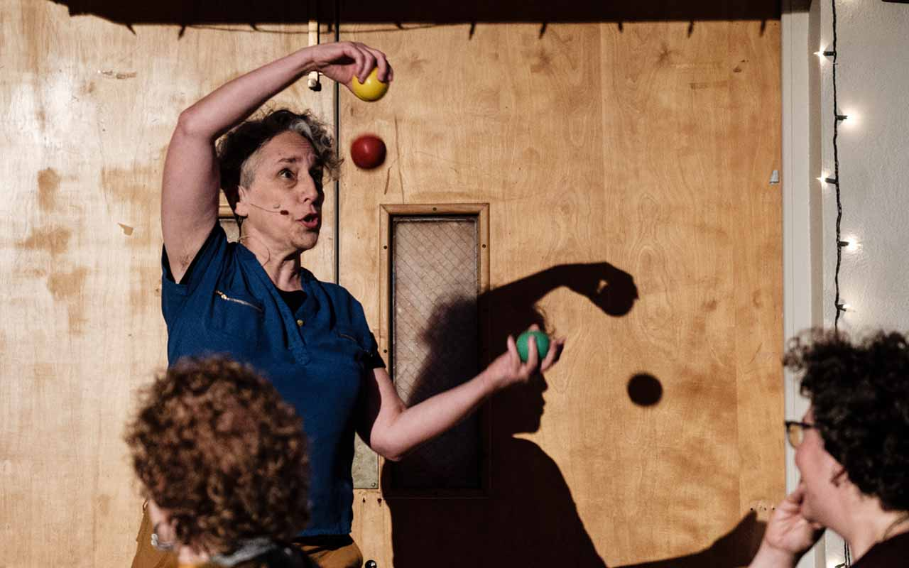 Sara Felder juggling and telling stories at LABA's DRUNK event at the East Bay JCC in Berkeley, Nov. 23, 2019. (Pete Rosos)