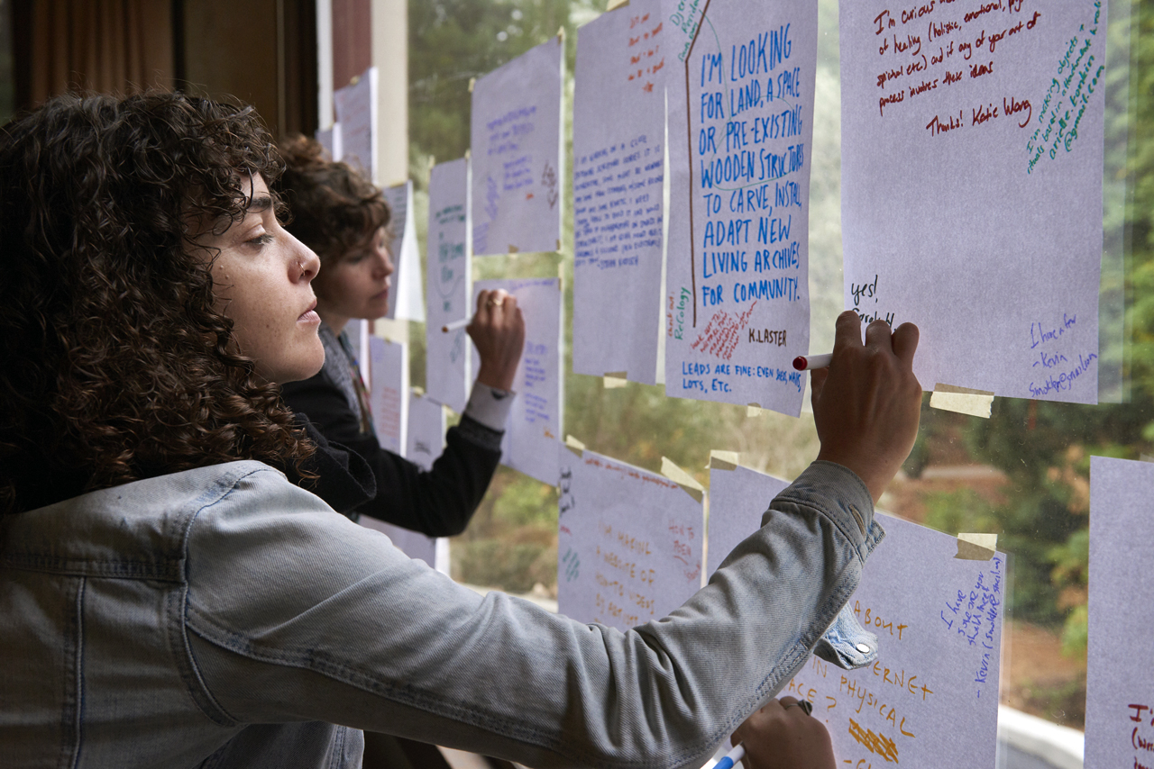 Writer Leora Fridman (left) responds to a project idea from dancer Katie Wong at the Asylum Arts retreat in Mill Valley, Nov. 11-14. (Stefan Cohen)