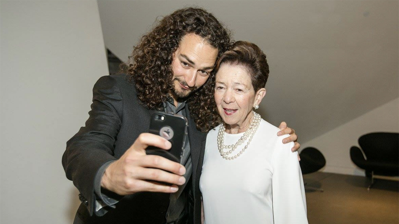 "Adam Swig and grandmother Roselyne ""Cissie"" Swig, take a selfie together at a Contemporary Jewish Museum event, 2016. (Cecile Hughes)"