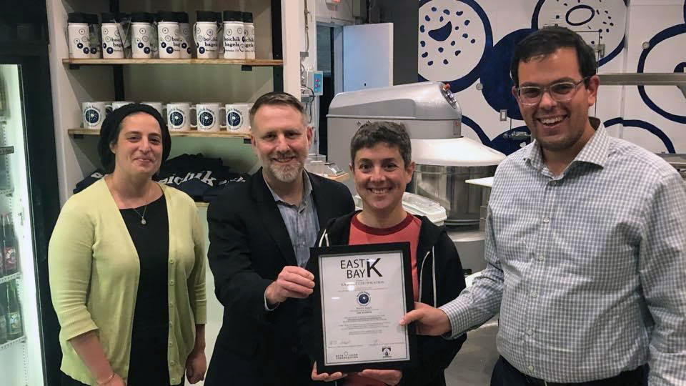(From left) Maharat Victoria Sutton and Rabbi Yonatan Cohen of Congregation Beth Israel, Boichik Bagels owner Emily Winston and Rabbi Gershon Albert of Beth Jacob Congregation show off Winston's new certification from East Bay Kosher. (Courtesy East Bay Kosher)