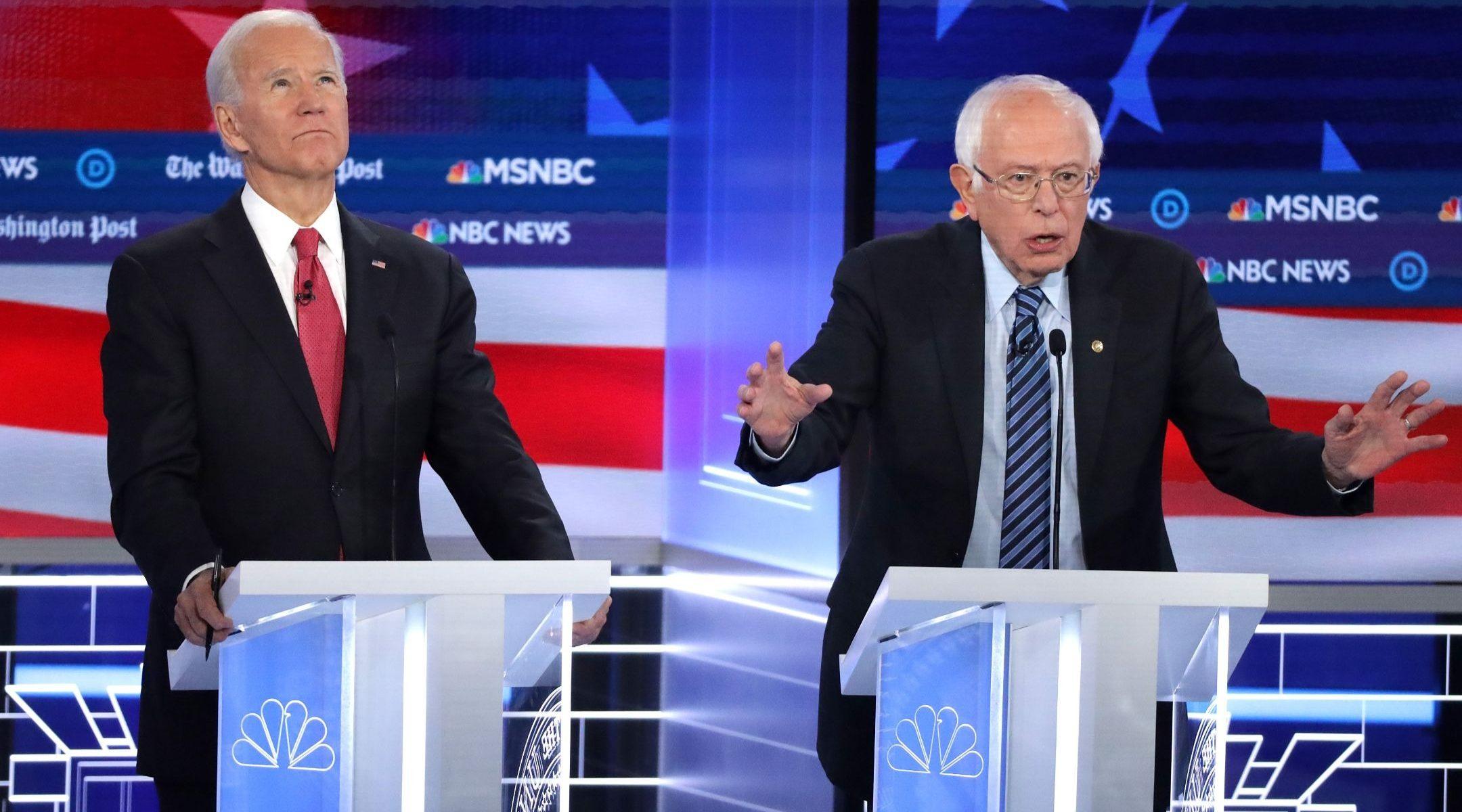 Joe Biden, left, listens as Sen. Bernie Sanders makes a point during the Democratic presidential debate in Atlanta, Nov. 20, 2019. (JTA/Alex Wong/Getty Images)