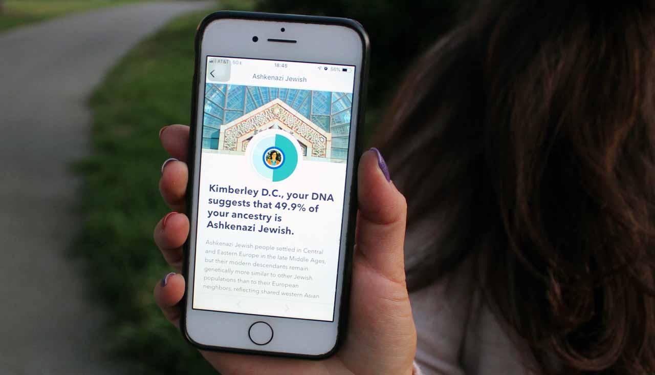 Kimberly Schroder shows off her 23andMe results. (Gabriel Greschler)