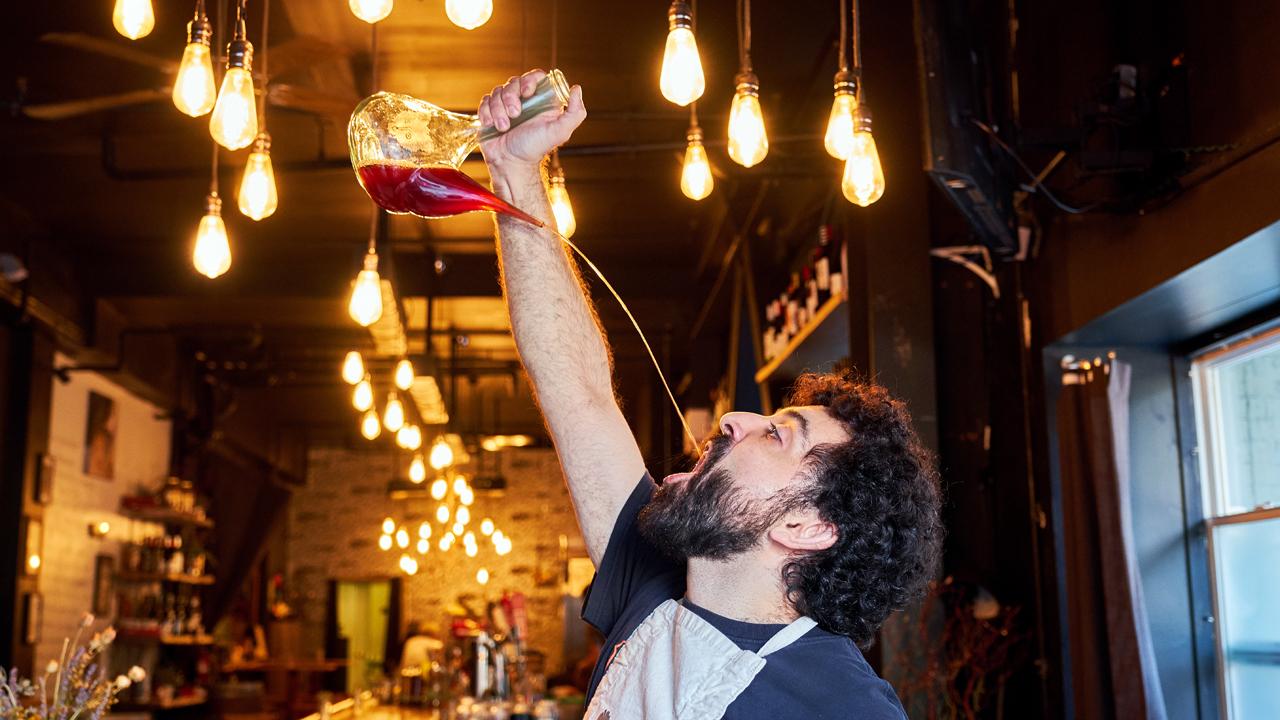 Daniel Azarkman drinking rose at his wine bar, El Lopo. (Andrew Curry)