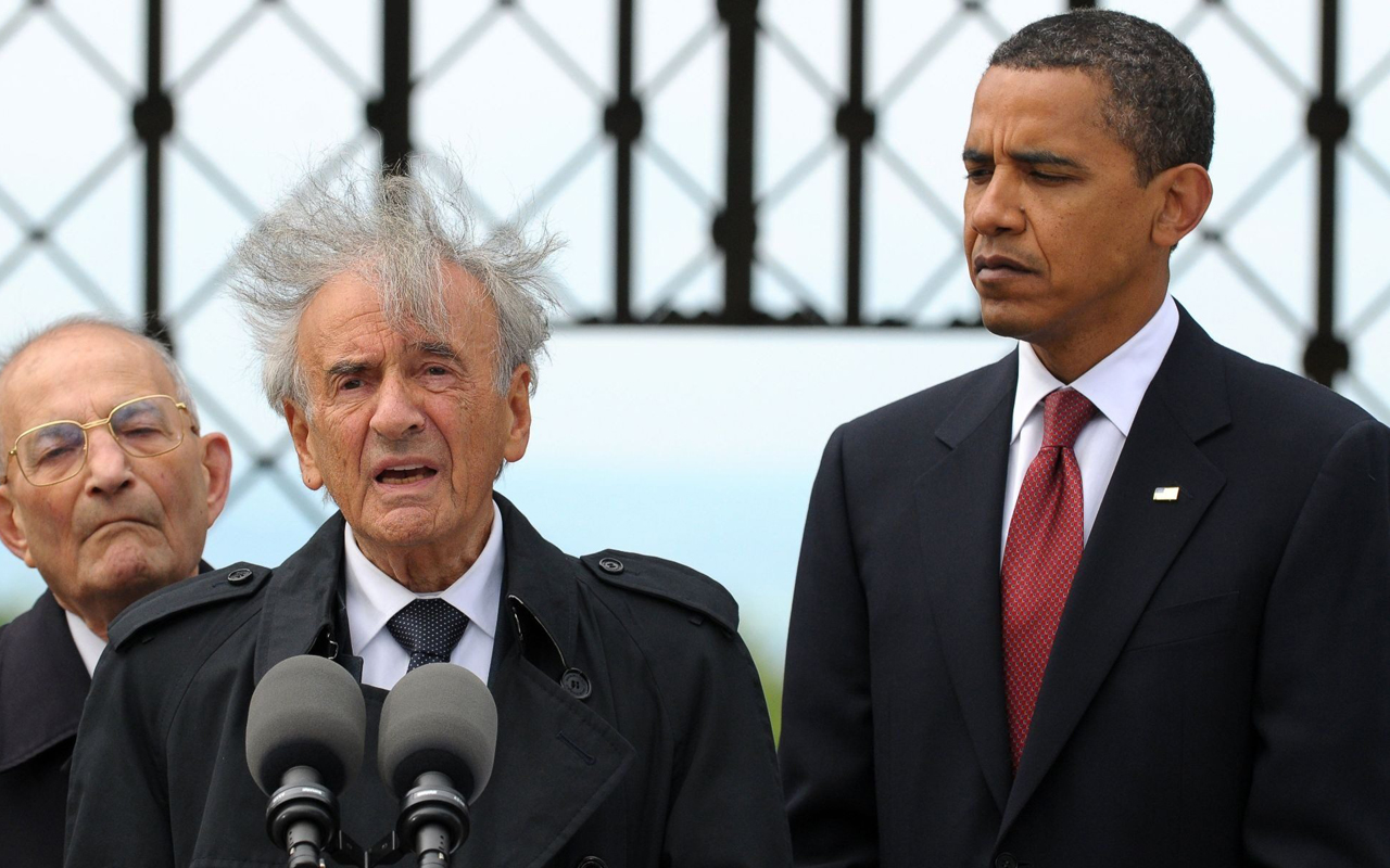 Buchenwald concentration camp survivor Elie Wiesel speaks while President Barack Obama and International Buchenwald Committee President Bertrand Herz listen during their visit of the former Buchenwald concentration camp near Weimar, Germany, June 5, 2009. (JTA/Pool/Getty Images)