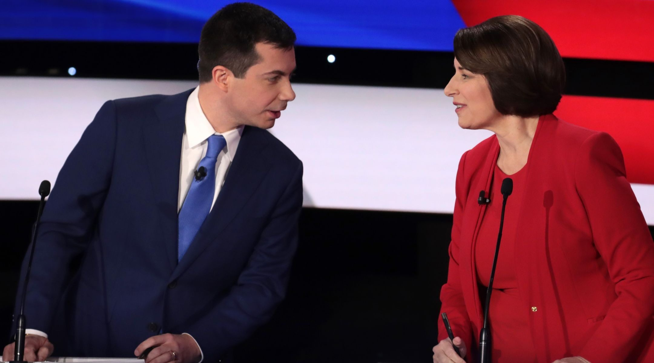 Sen. Amy Klobuchar (D-MN) and former South Bend, Indiana Mayor Pete Buttigieg speak during the Democratic presidential primary debate at Drake University in Des Moines, Iowa on January 14, 2020.  (JTA/Scott Olson/Getty Images)
