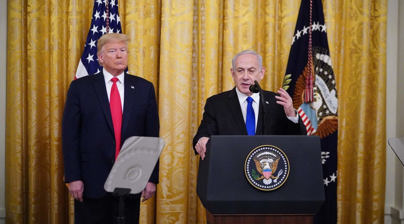 President Donald Trump and Israeli Prime Minister Benjamin Netanyahu take part in an announcement of Trump's Middle East peace plan in the East Room of the White House, Jan. 28, 2020. (JTA/Mandel Ngan/AFP via Getty Images)