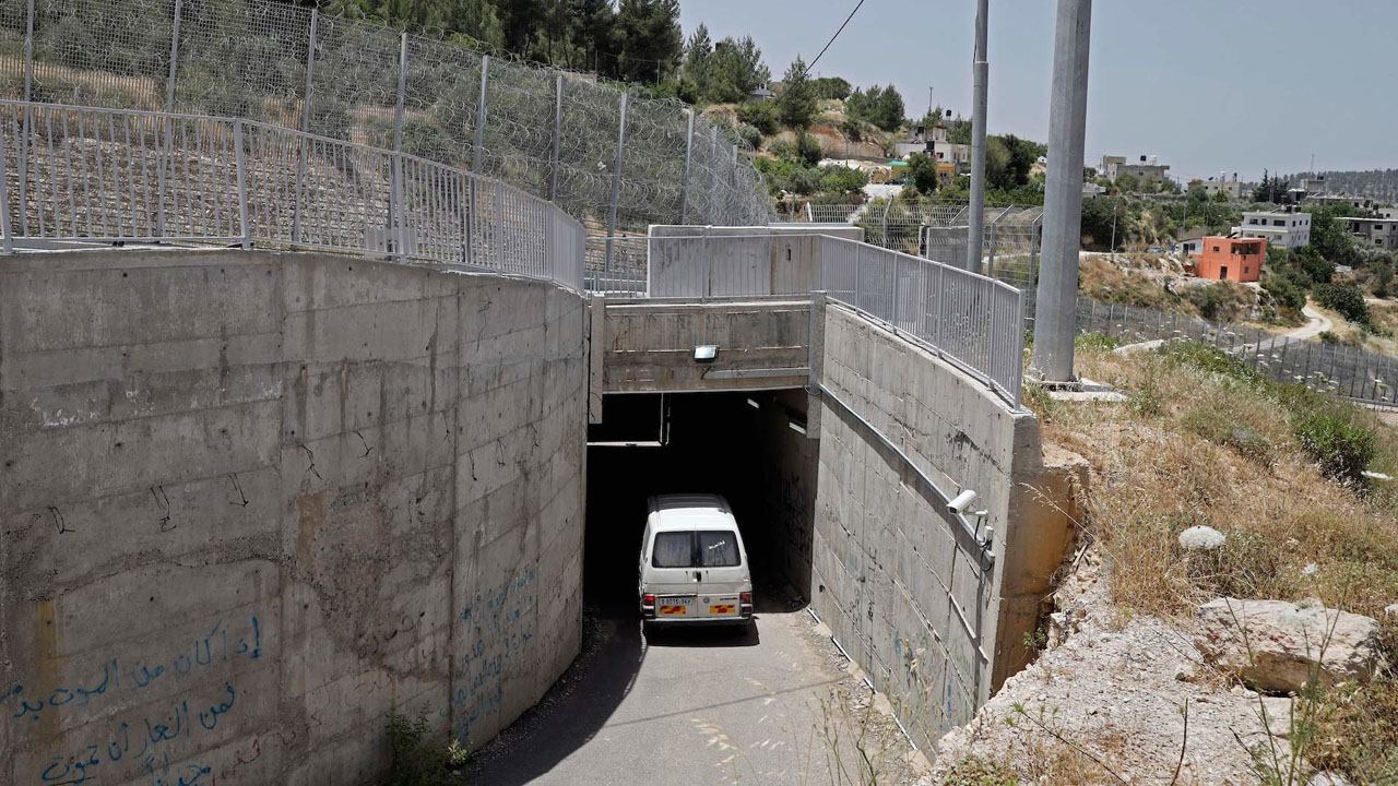 A car driving in a tunnel near the West Bank village of al-Walajah, May 30, 2019. (JTA/Thomas Coex/AFP via Getty Images)