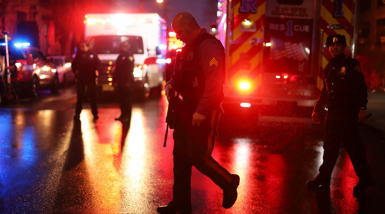 Police officers on the scene of a shooting at kosher grocery store in Jersey City, N.J., that left six dead, Dec. 10, 2019. (JTA/Rick Loomis/Getty Images)