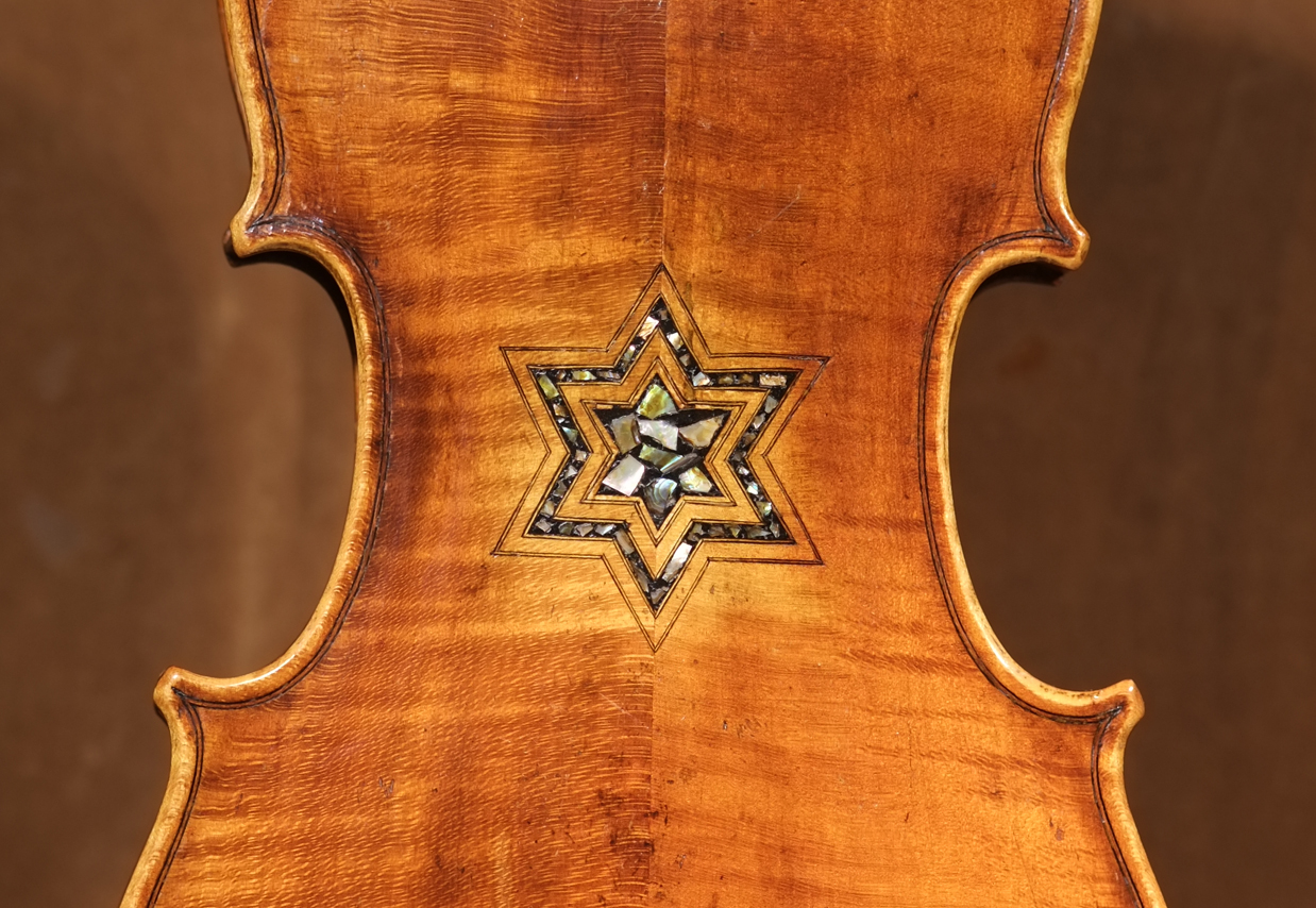 Photos of violins like this one, made in Germany around 1870, will be featured in one of dozens of Violins of Hope events, January through March around the Bay Area. (Amnon Weinstein)