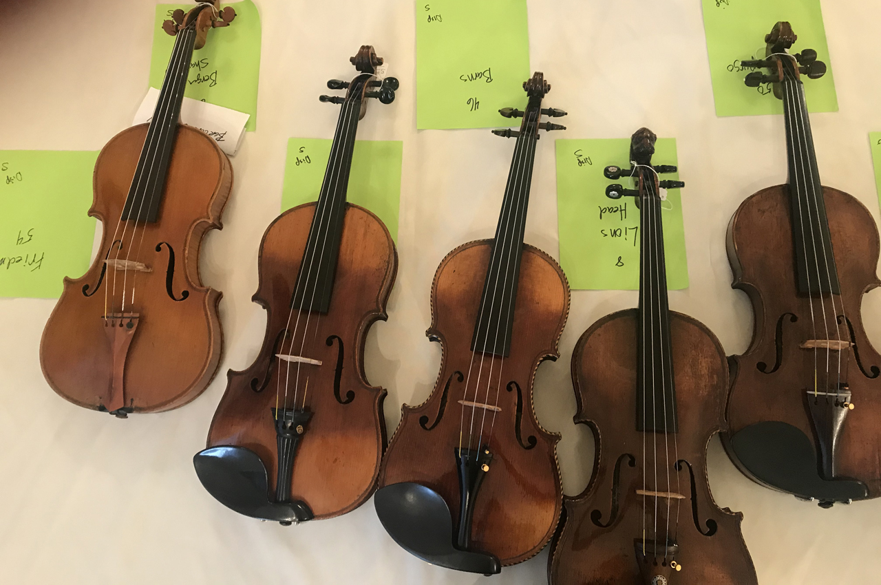 """Some of the violins that have come to the Bay Area as part of """"Violins of Hope."""" (Laura Paull)"""