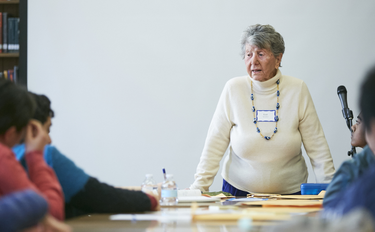 Lori, a Holocaust survivor from the JFCS Holocaust Center speakers' bureau, addresses students in March 2019. (Photo/Trish Tunney)
