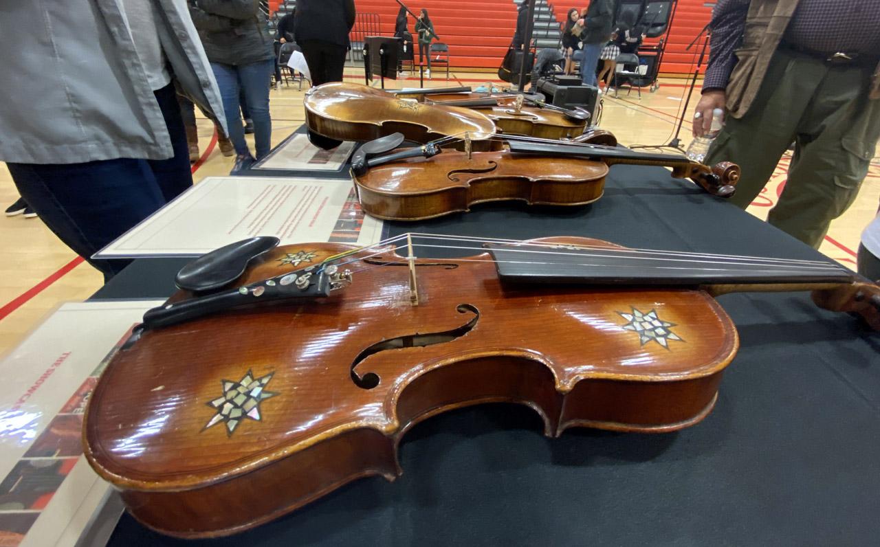 Holocaust-era violins on display at Mercy High School. (Gabriel Greschler)