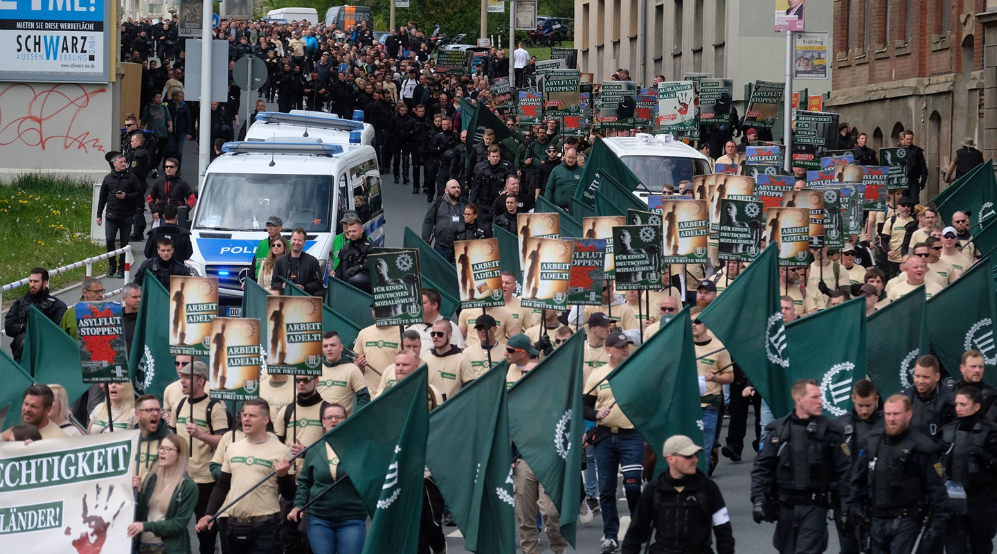 Far-right and neo-Nazi supporters walk through Plauen in eastern Germany, May 1, 2019. (JTA/Sebastian Willnow/DPA/AFP via Getty Images)