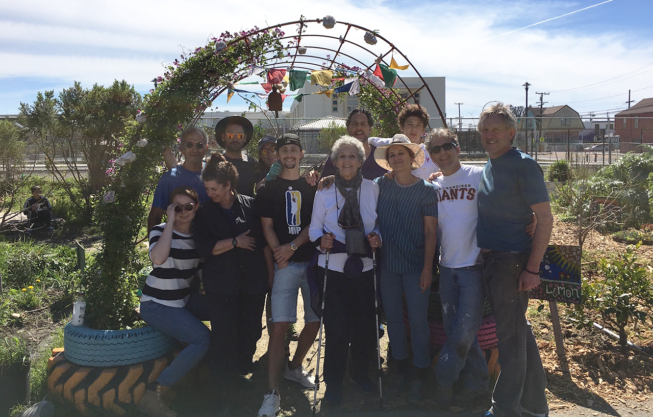 The extended Trachtenberg family, plus friends, at the entry to Allen's Garden during a work party day, a few years ago. Front and center, in white blouse, is Mitzi Trachtenberg, widow of Allen. She died Feb. 8, 2020. (Courtesy Julie Trachtenberg)