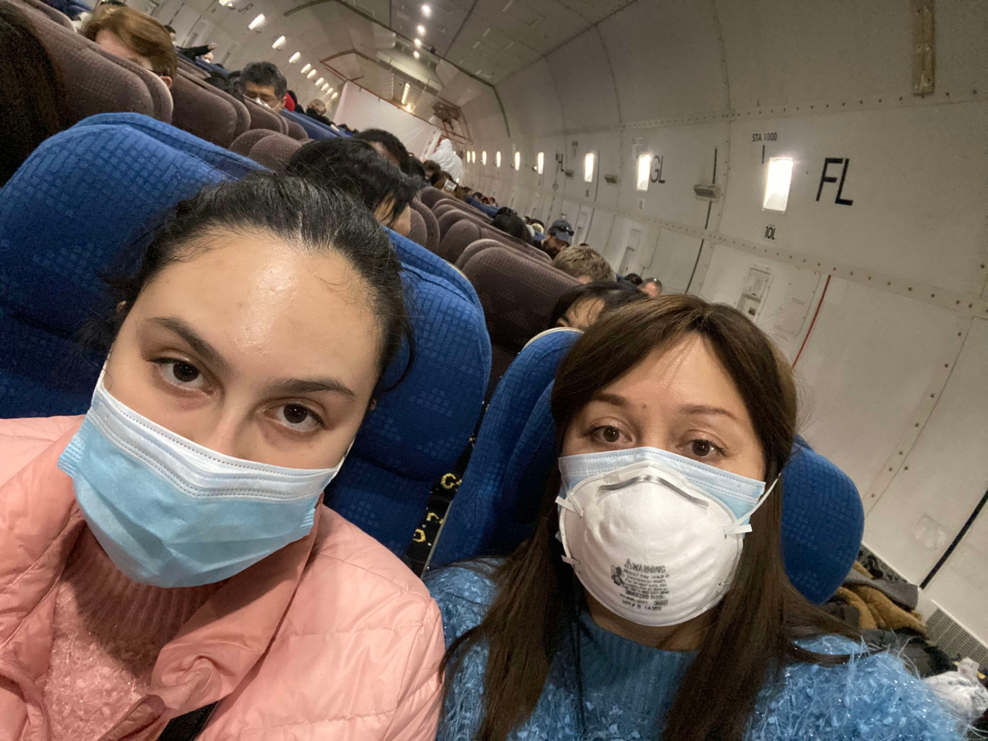 Esther Tiferes Tebeka and her 15 year-old daughter (left) on the American evacuation plane from Wuhan, China. (Esther Tiferes Tebeka)