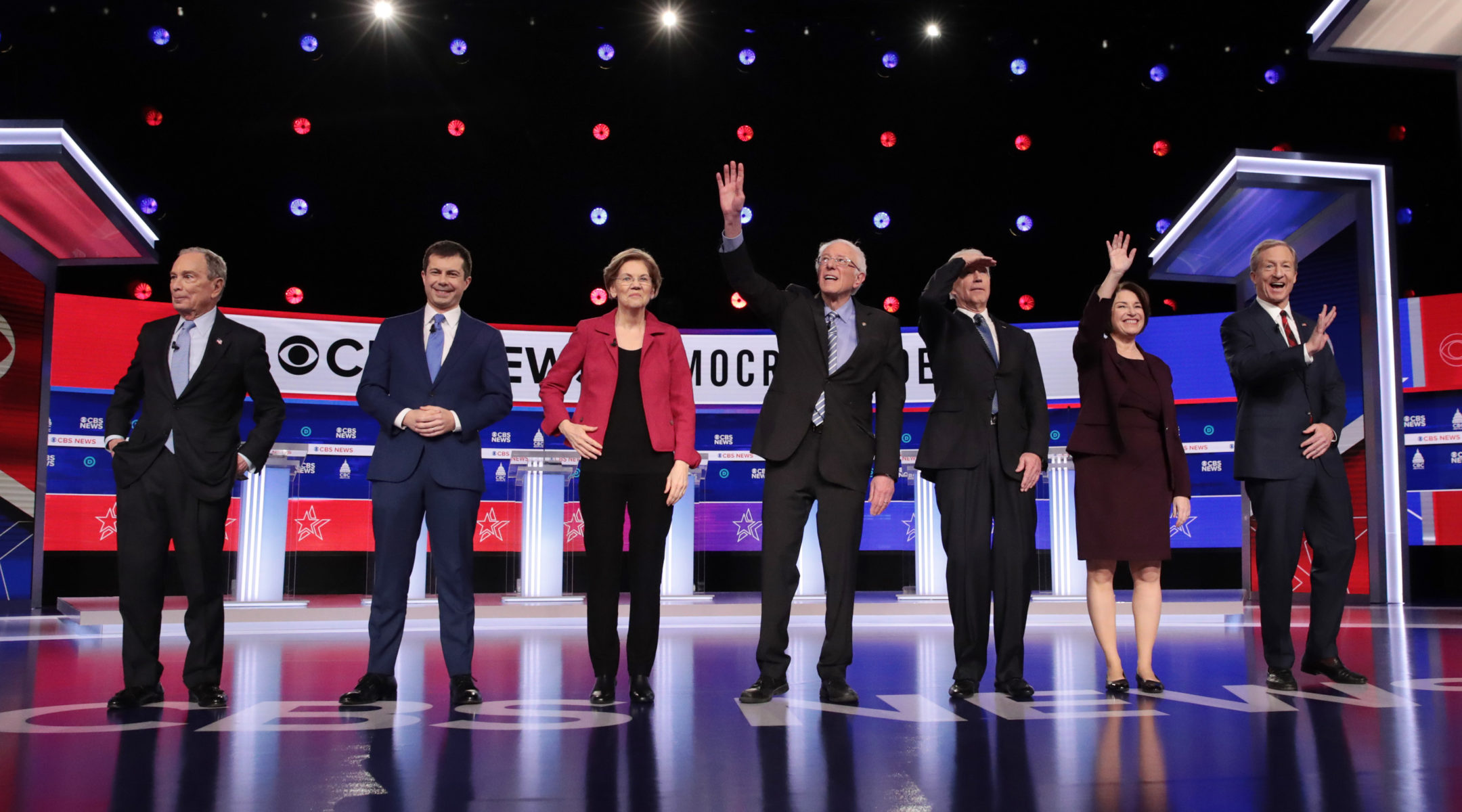 Democratic presidential candidates (L-R) former New York City Mayor Mike Bloomberg, former South Bend, Indiana Mayor Pete Buttigieg, Sen. Elizabeth Warren (D-MA), Sen. Bernie Sanders (I-VT), former Vice President Joe Biden, Sen. Amy Klobuchar (D-MN), and Tom Steyer arrive on stage for the Democratic presidential primary debate on Feb. 25, 2020 in Charleston, South Carolina. (JTA/Scott Olson/Getty Images)