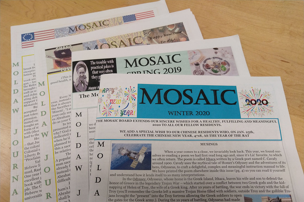 Copies of Mosaic, the quarterly journal by seniors at the Moldaw Residences in Palo Alto. (Maya Mirsky)