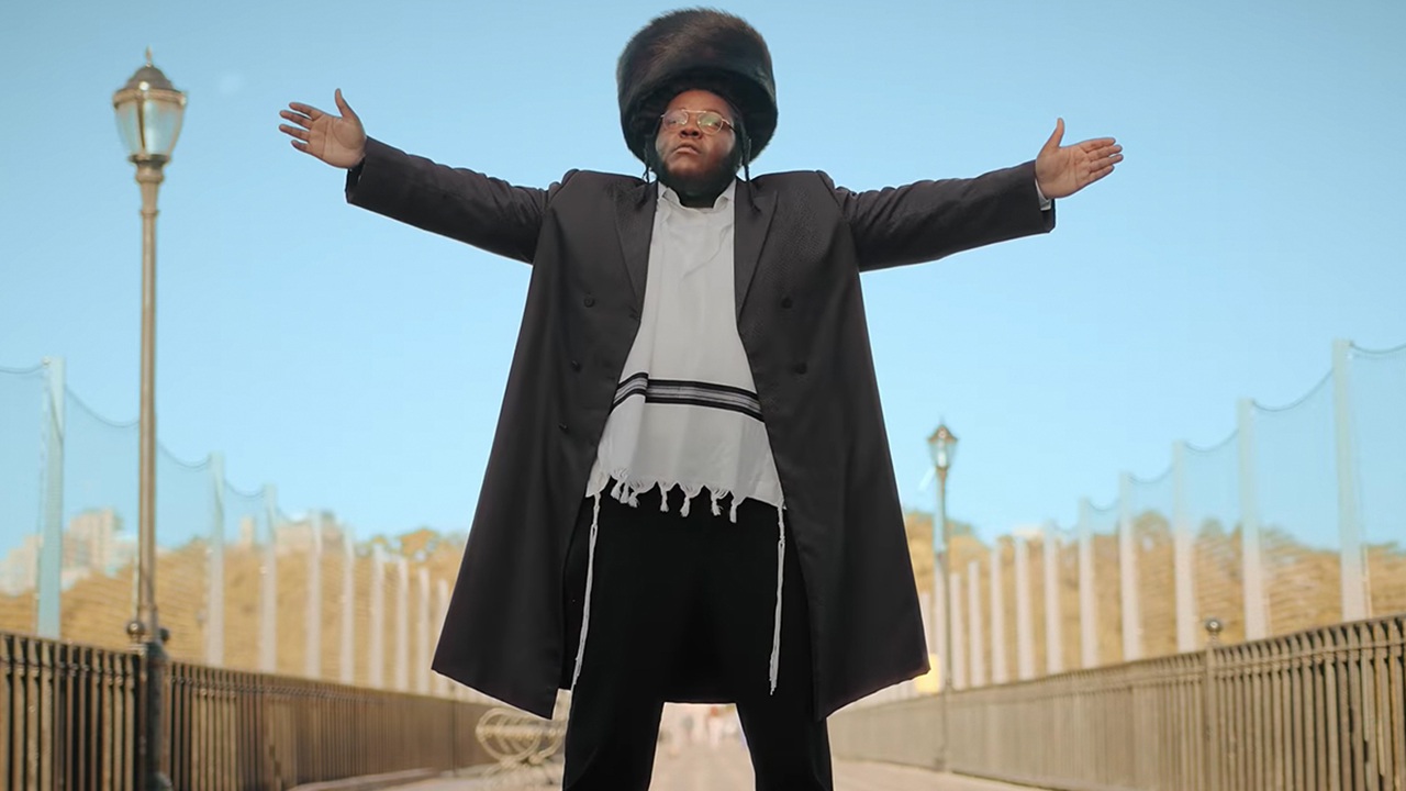 "Rapper Nissim Black's new single says that he's ""Hitler's worst nightmare."" (Screenshot from ""Mothaland Bounce"" video)"