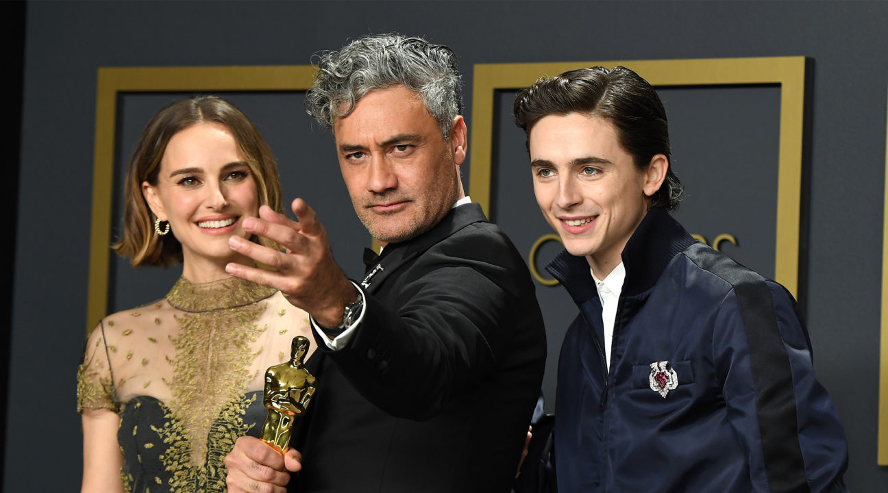 Jewish stars Natalie Portman, Taika Waititi and Timothée Chalamet pose in the press room during the 92nd Annual Academy Awards (JTA/Steve Granitz/WireImage)