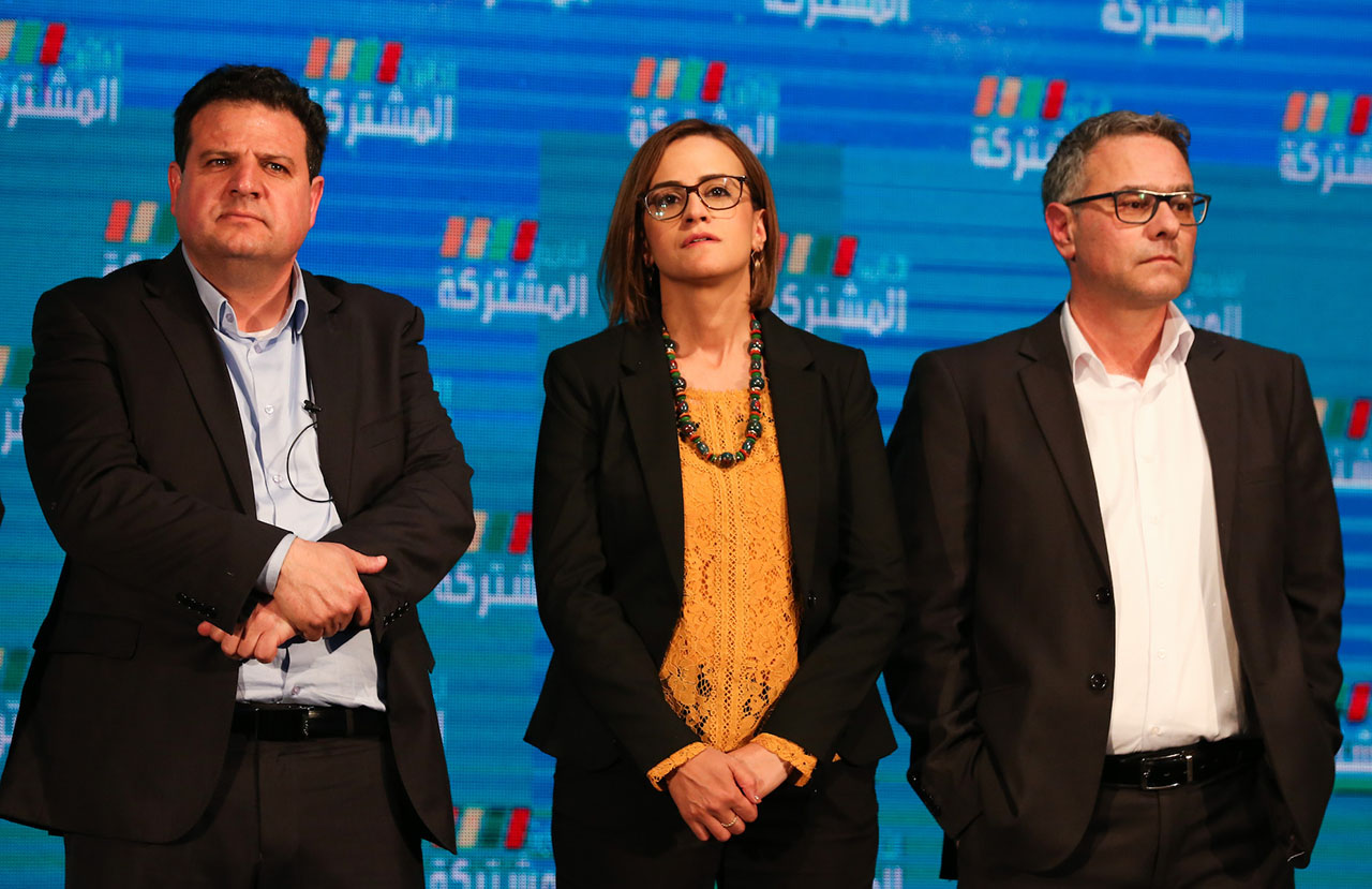 Ayman Odeh, leader of the Joint List (left), with other party members at the party headquarters in the Arab-Israeli city of Shfaram, March 2, 2020. (JTA/DAVID COHEN/FLASH90)