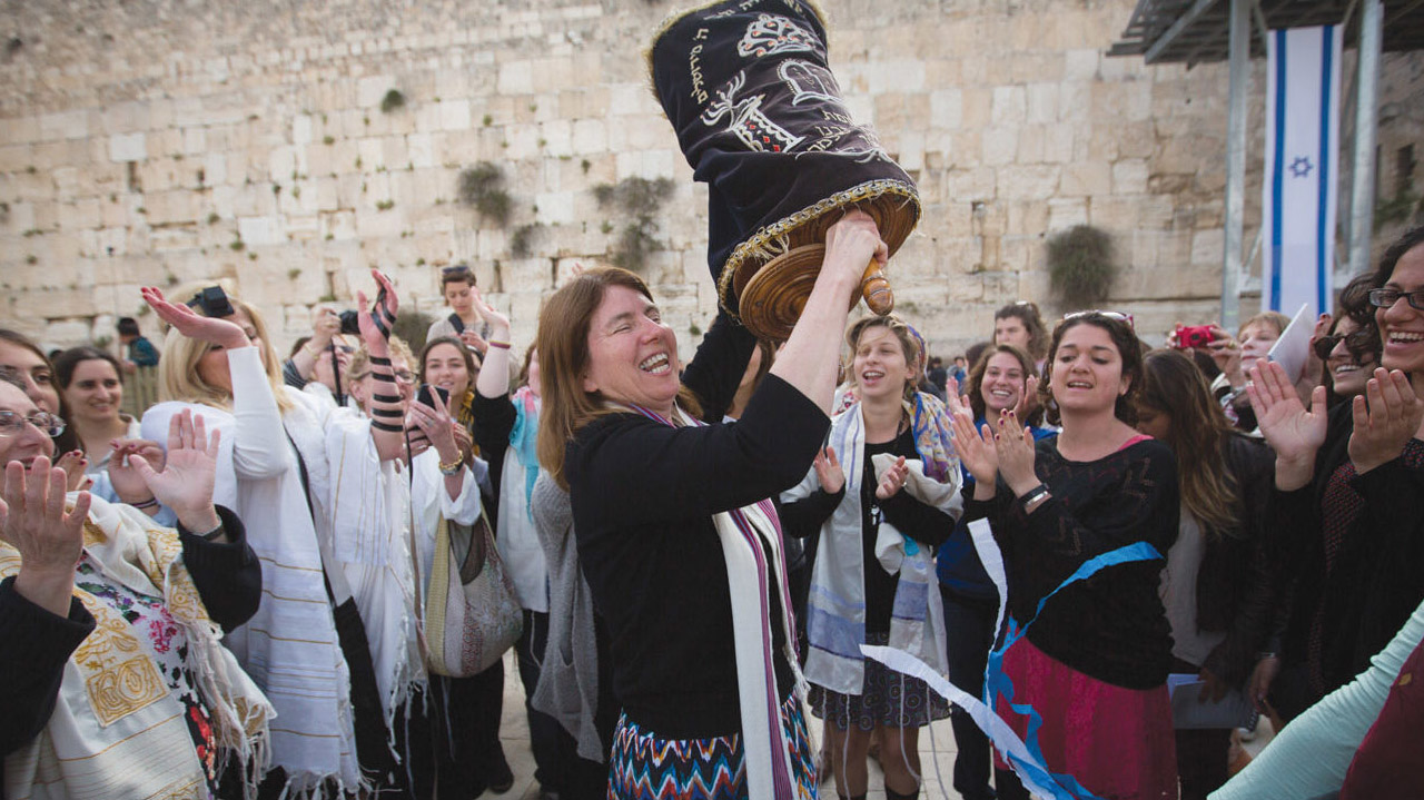 Rabbi Beth Singer of S.F. Congregation Emanu-El — one of several local Jews running to help represent diaspora Jews in the 38th World Zionist Congress — dancing with a Torah during Women of the Wall's monthly service at the Western Wall, April 2015. (JTA/FLASH90/MIRIAM ALSTER)