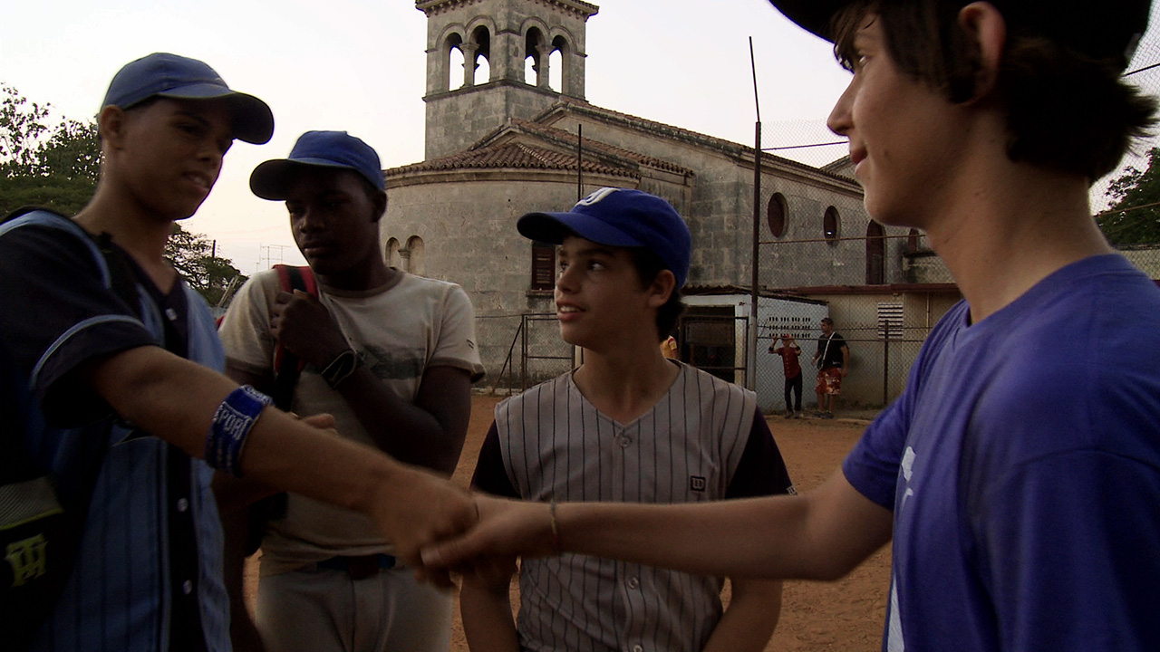 "San Franciscan Mica Jamel-Schneider greet some baseball-loving Cuban peers in a still from ""Havana Curveball."""