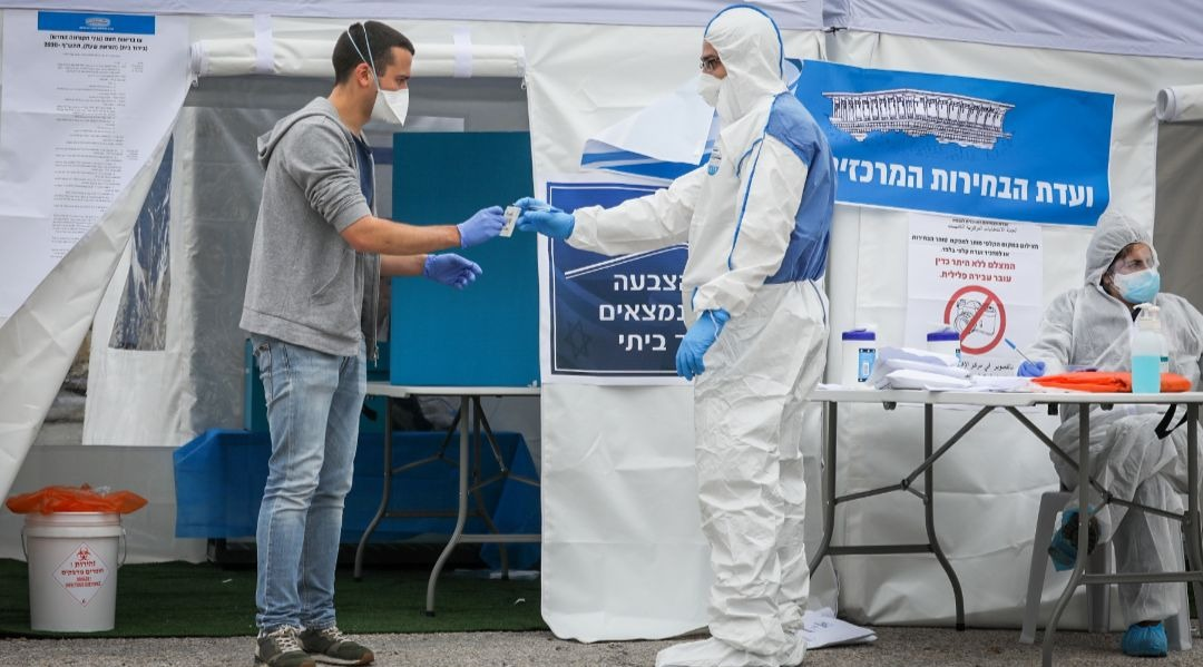 Israeli voters in quarantine due to possible exposure to coronavirus vote at a special polling station in Jerusalem during national elections, March 2, 2020. (JTA/Nati Shohat/Flash90)