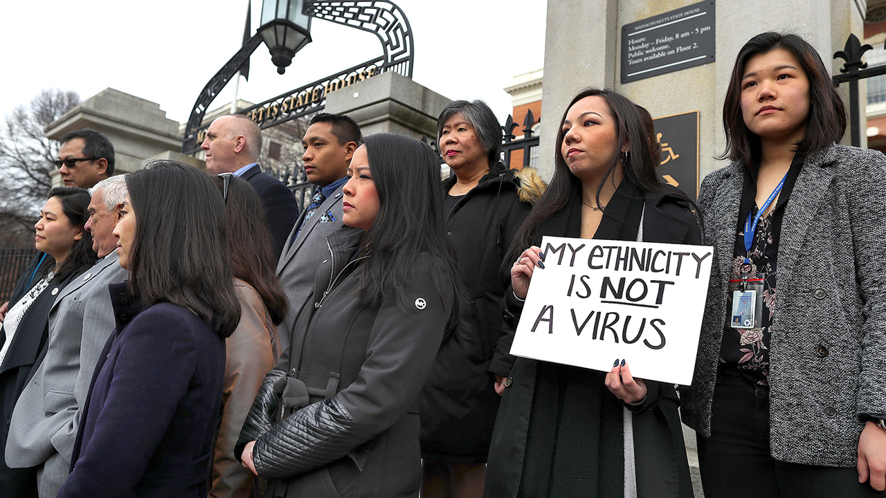 Members of the Asian American Commission hold a press conference on the steps of the Massachusetts State House to condemn racism towards the Asian American community because of coronavirus on March 12, 2020 in Boston. (JOHN TLUMACKI/THE BOSTON GLOBE via GETTY)