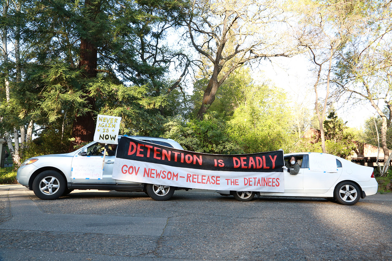 Protesters keep their social distance while protesting outside Gov. Gavin Newsom's residence in Fair Oaks. (MOLLY STUART)