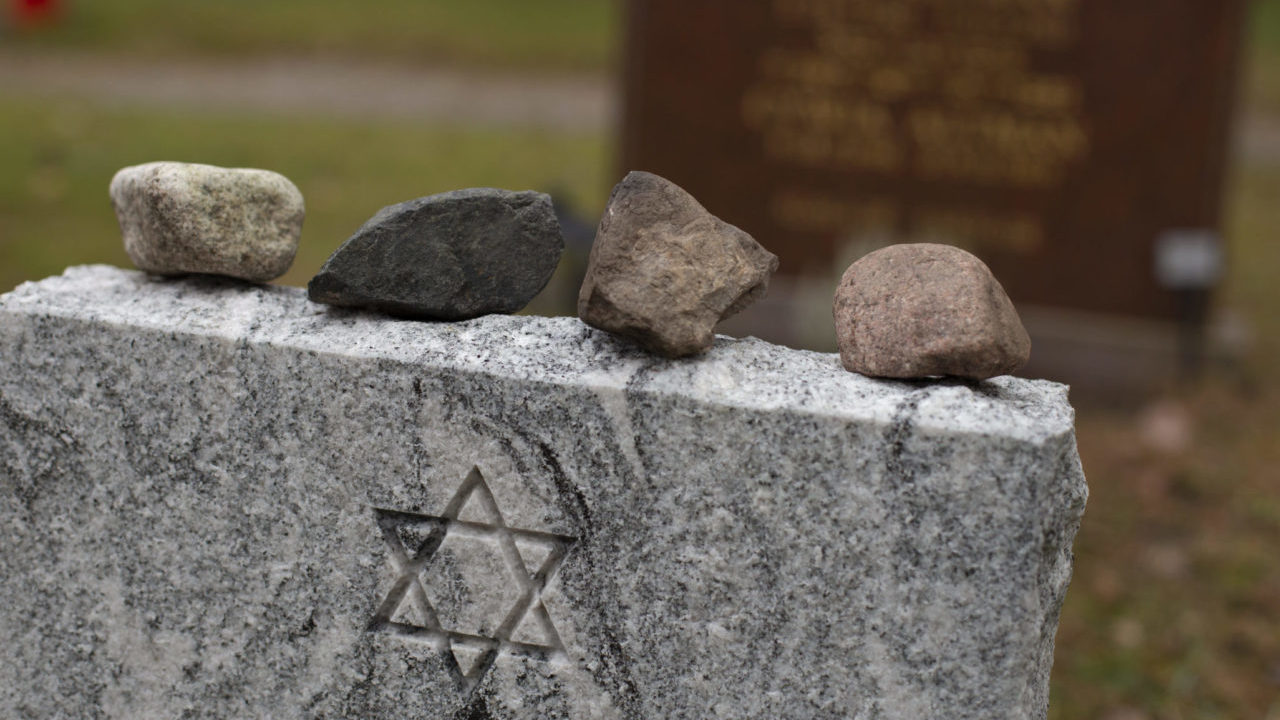 Placing stones on a headstone at a Jewish cemetery honors the deceased. (Photo/JTA-Getty Images)