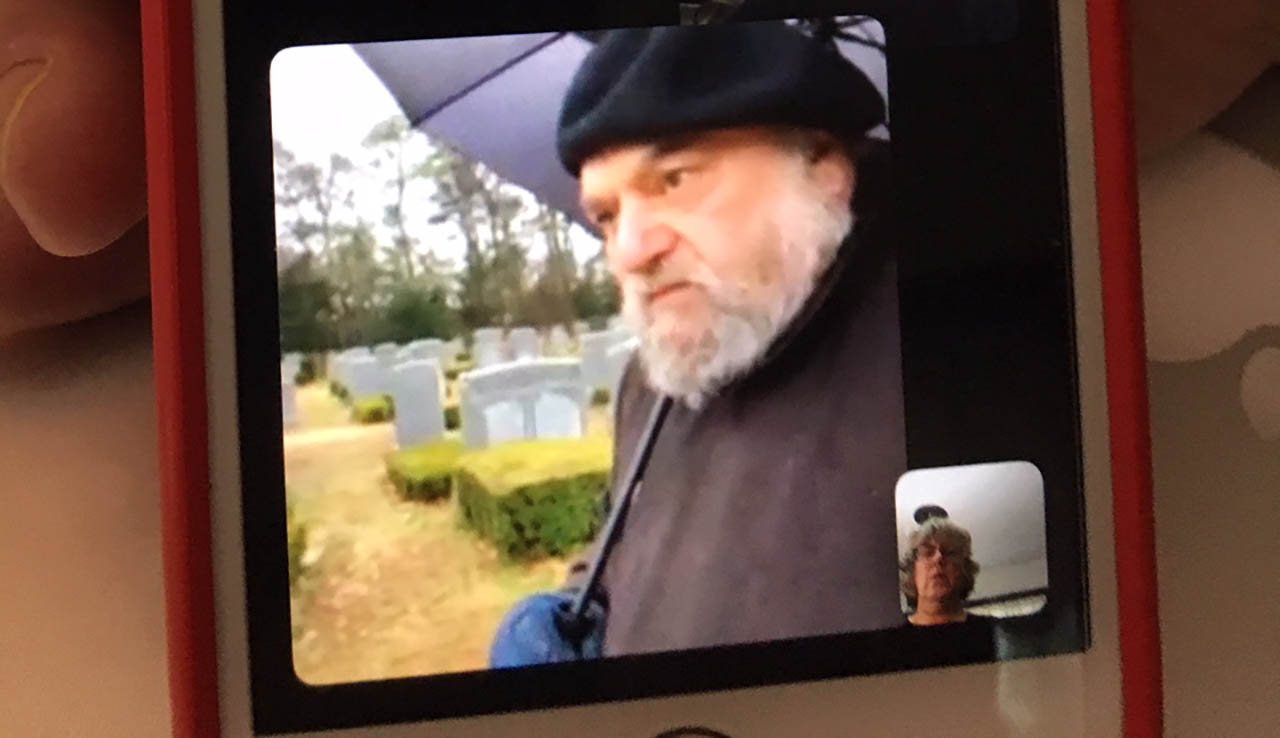 A FaceTime funeral streamed from New York to Berkeley on a snowy day. (DAPHNE WHITE)