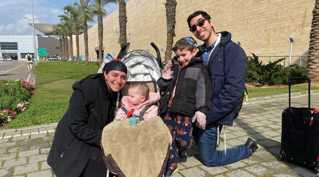 """Joel and Tsipporah Adelman before their flight to Israel, where they say they are going a bit """"stir crazy"""" in quarantine. (JTA/COURTESY ADELMANS)"""