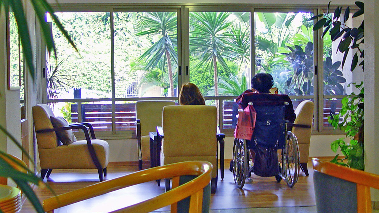 two women sitting in a retirement home