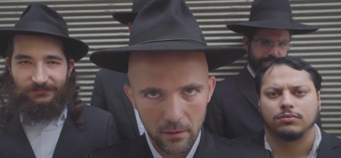 "Kosha Dillz in his music video for ""Schmoozin'."" (Screenshot/YouTube)"