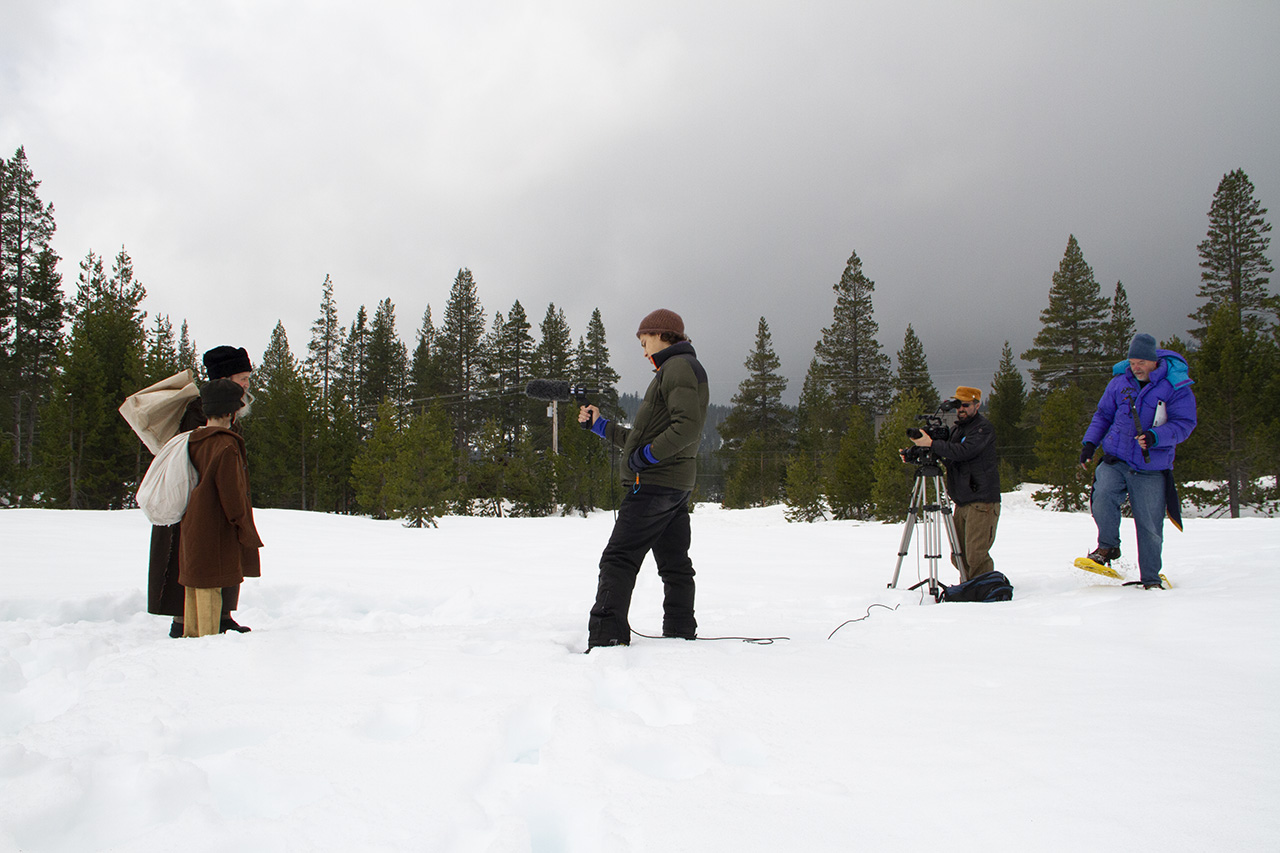 "Yoav Potash (second from right) directs a reenactment scene for his forthcoming documentary ""Diary from the Ashes."" (CIRRUS WOOD)"