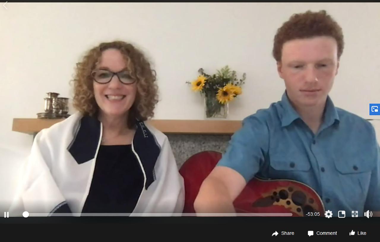 Rabbi Stacey Friedman of Congregation Rodef Sholom livestreams Havdalah with son Eli.