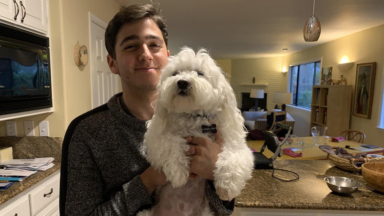 Jeremy Bruner, a senior at Bentley Upper School in Lafayette, with his dog Snowy. (EDEN BRUNER)