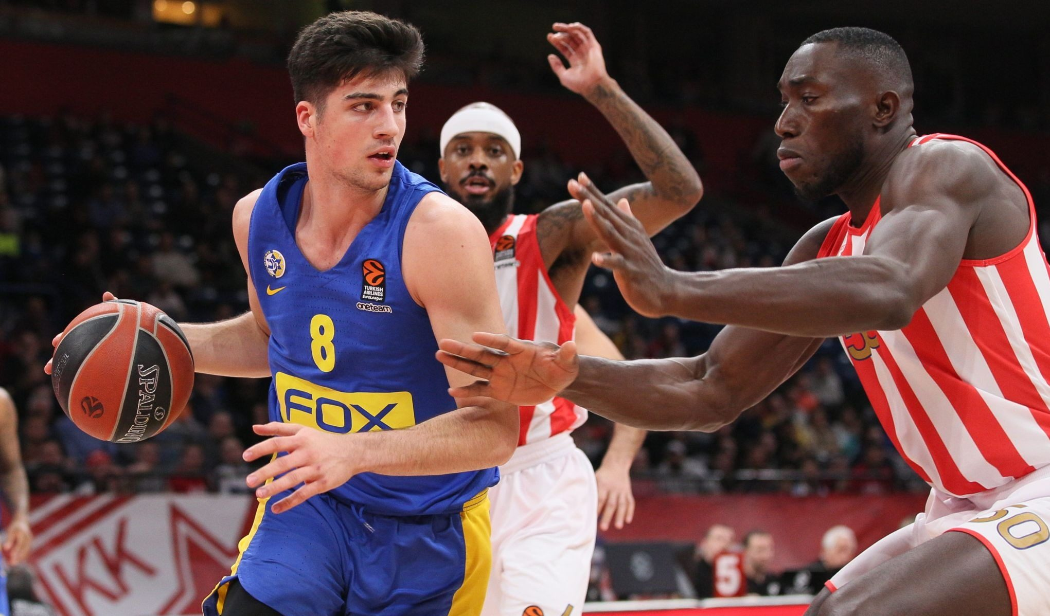 Deni Avdija (left) of Maccabi Tel Aviv handles the ball against the Serbian team Crvena Zvezda in a EuroLeague game in Belgrade, March 6, 2020. (Photo/JTA-Marko Metlas-Euroleague Basketball via Getty Images)