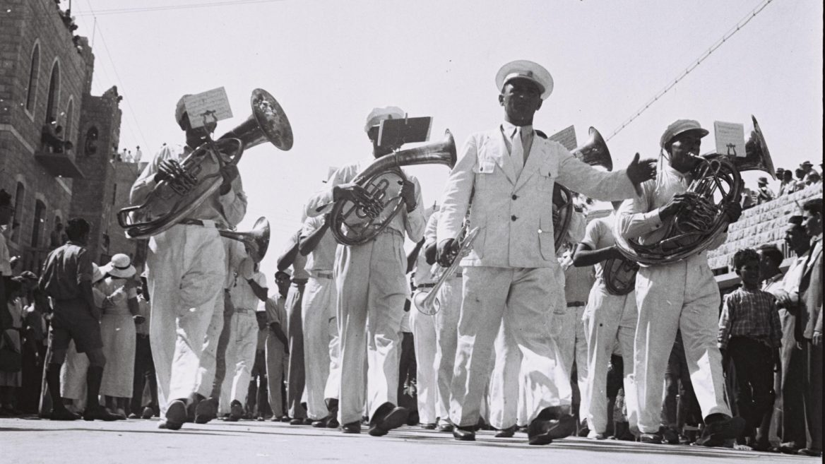 The Haifa Municipal Band playing in the 1933 Bikurim parade. (Photo/ GPO via Wikipedia)
