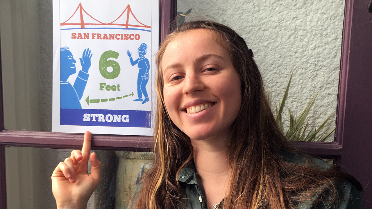 Miriam Streicker-Hirt with an S.F. Strong poster created by Susan Stanger.