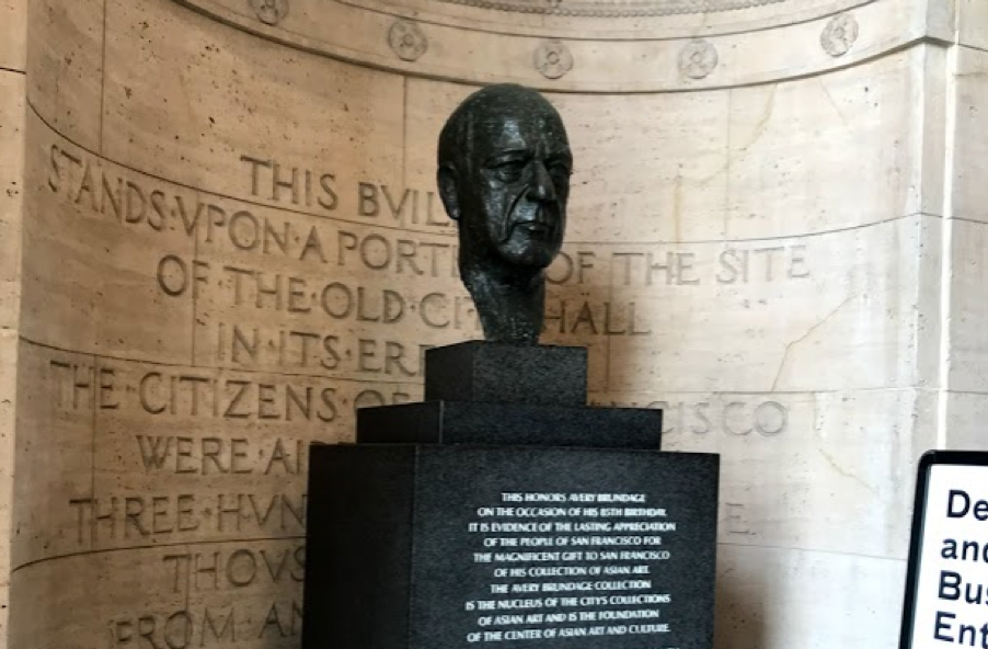 Bust of older white man displayed in museum entryway
