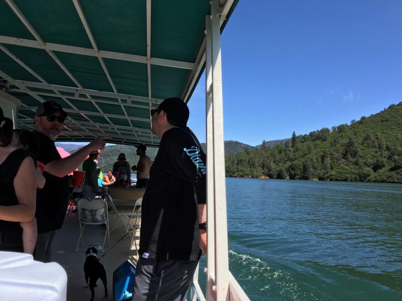 Two men speak on a boat