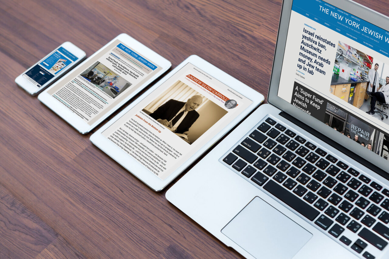 a smartphone, two tablets and laptop on a table, all on the Jewish Week website
