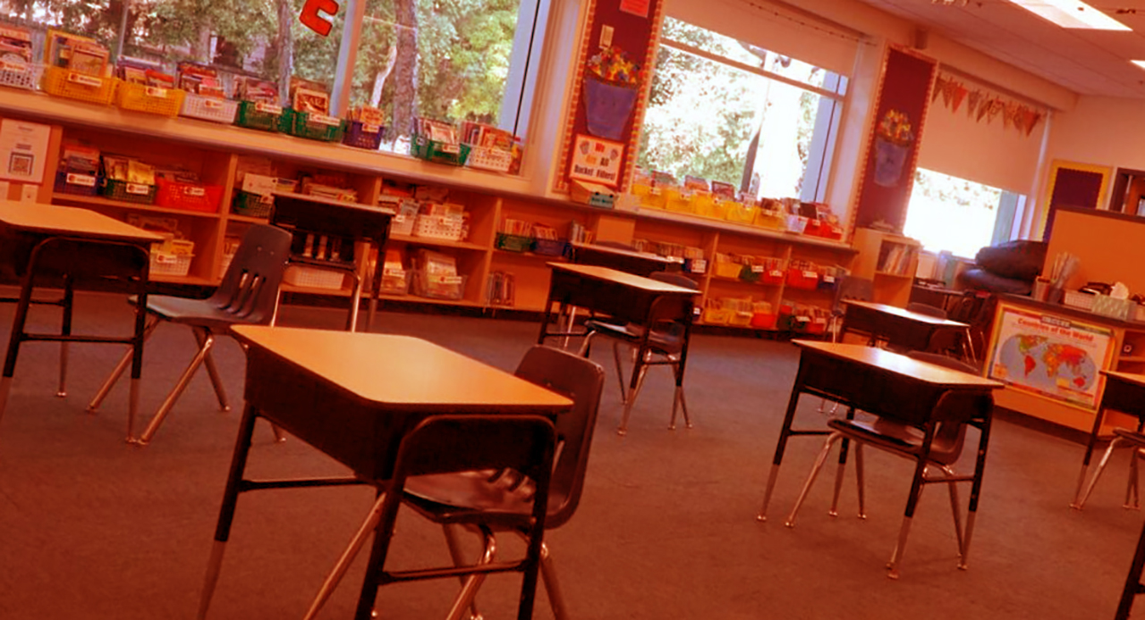 a classroom with desks spaced evenly throughout