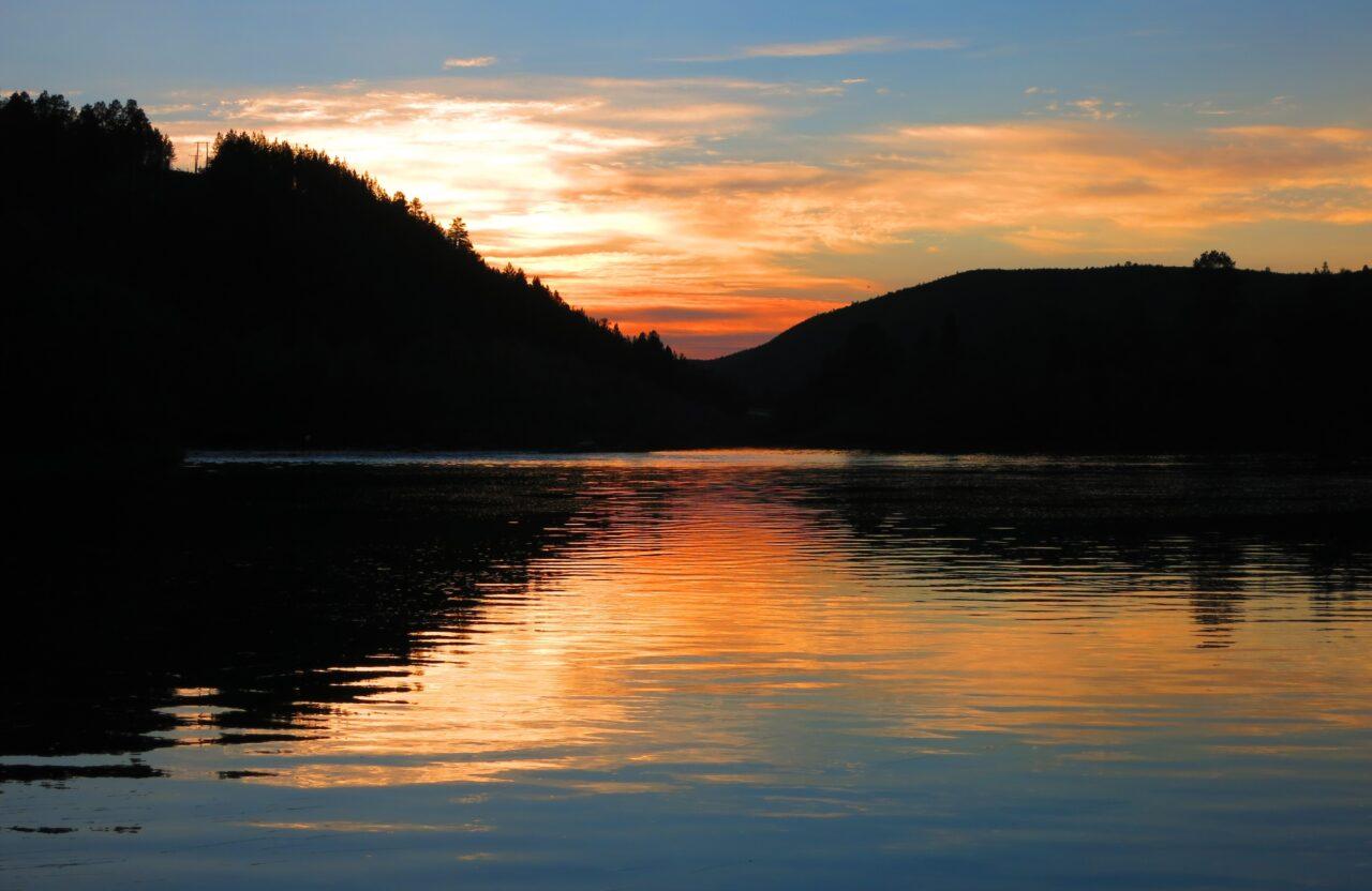 landscape photo of a dusky sunset over a lake