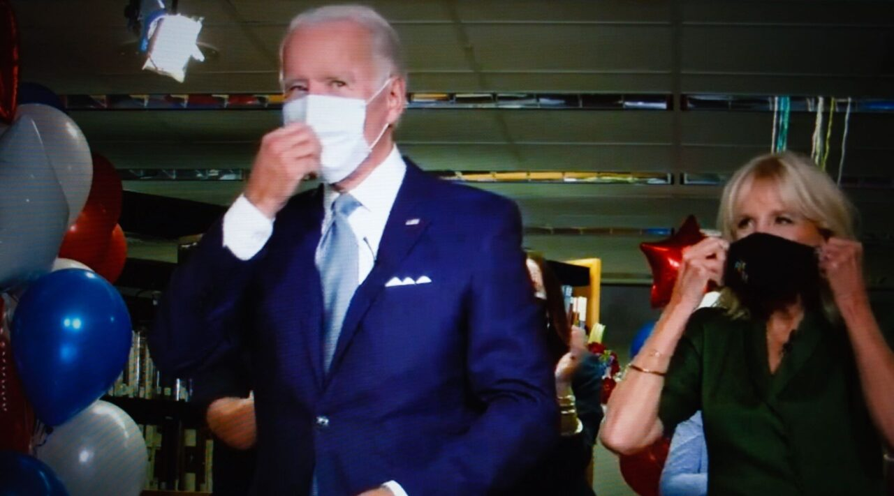 Joe and Jill Biden stand with masks on