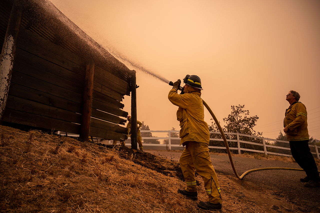 U.S. Air Force firefighters from Edwards Air Force Base, seen here extinguishing a fire in Vacaville Aug. 21, have been deployed across the North Bay to help contain the wildfires. (Photo/U.S. Air Force-Nicholas Pilch)